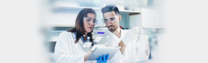 Two people look at the Lab Assistant Tool in the laboratory.jpg